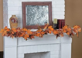 Mantel Decorated with Glittery Maple Leaf Garland